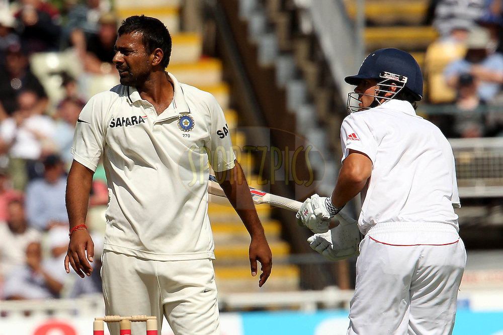Praveen Kumar and Alistair Cook during day two of the third test match between England and India held at Edgbaston Cricket ground in Birmingham on the 11th August 2011...Photo by Ron Gaunt/SPORTZPICS/BCCI