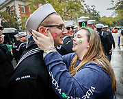 A sailor from the USS Alaska gets kissed as he marches in the 194-year-old Savannah St. Patrick's Day parade, Saturday, March 17, 2018, during the St. Patrick's Day parade in Savannah, Ga. (AP Photo/Stephen B. Morton)