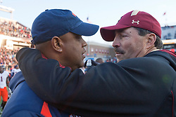 November 20, 2010; Chestnut Hill, MA, USA;  Virginia Cavaliers head coach Mike London (left) embraces Boston College Eagles head coach Frank Spaziani (right) after the game at Alumni Stadium.  Boston College defeated Virginia 17-13.