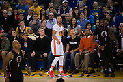 Fans watch a three point shot by Golden State Warriors guard Stephen Curry (30) against the LA Clippers at Oracle Arena in Oakland, Calif., on January 28, 2017. (Stan Olszewski/Special to S.F. Examiner)