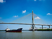 29 OCTOBER 2018 - PHRA PRADAENG, SAMUT PRAKAN, THAILAND: Boats go under Bhumibol 2 Bridge in Samut Prakan province, east of Bangkok. The Chao Phraya River is the lifeline of central Thailand. Water from the river, and its tributaries, provides domestic and agricultural water to homes and farms. It's also a major commercial artery with large ocean going freighters going up to Bangkok's Khlong Toey port.         PHOTO BY JACK KURTZ