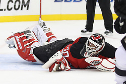 Oct 13; Newark, NJ, USA; New Jersey Devils goalie Martin Brodeur (30) grimaces after diving to the ice during the first period at the Prudential Center.