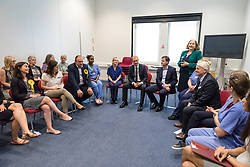 © Licensed to London News Pictures. 01/06/2017. London, UK. Leader of the Liberal Democrats TIM FARRON (centre) speaks with staff at Kingston Hospital, joined by former leader Nick Clegg and Sarah Olney MP. Photo credit: Rob Pinney/LNP
