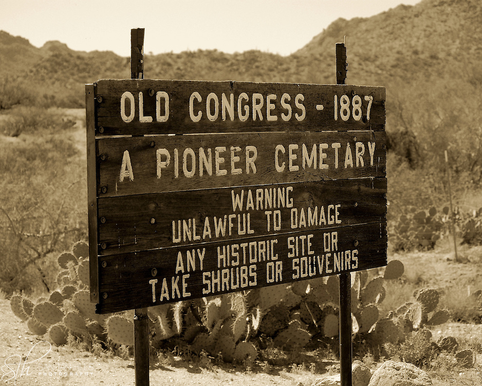 A sign warns visitors against removing items from the site, near the entrance to the pioneer cemetery, in Old Congress, AZ