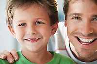 Father and Son smiling head and shoulders portrait