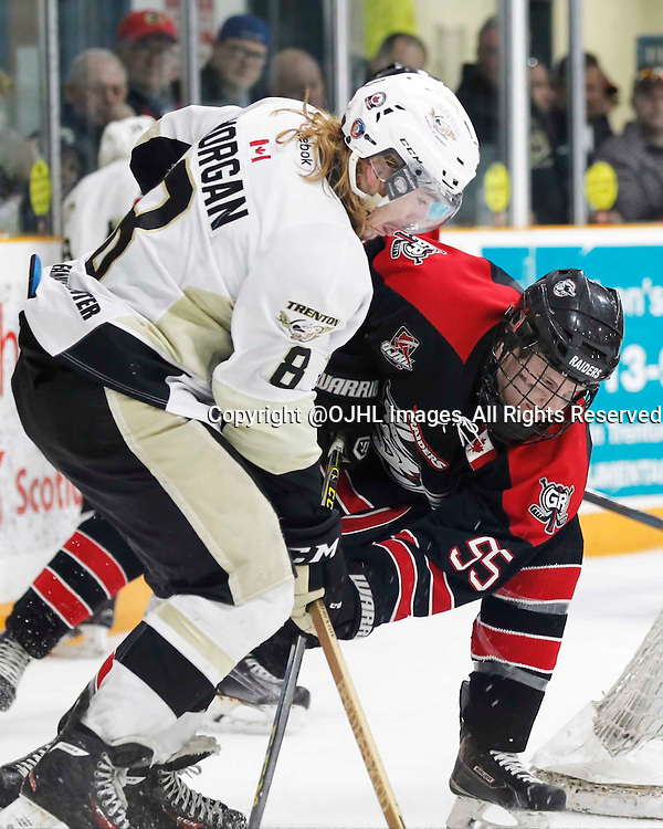 TRENTON, - Apr 21, 2016 -  Ontario Junior Hockey League game action between the Trenton Golden Hawks and the Georgetown Raiders. Game 5 of the Buckland Cup Championship Series, Liam Morgan #8 of the Trenton Golden Hawks and Matthew Cairns #55 of the Georgetown Raiders battle for the puck at the Duncan Memorial Gardens, ON. (Photo by Amy Deroche / OJHL Images)