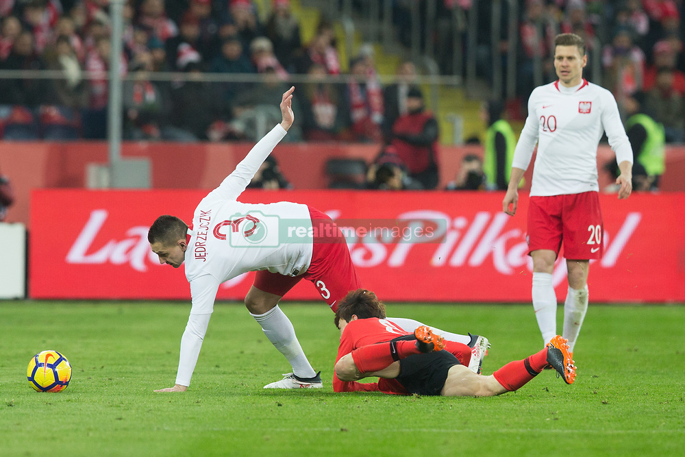 March 27, 2018 - Chorzow, Poland - Lukasz Piszczek and Artur Jedrzejczyk of Poland vie Jae-sung Lee (KOR)   during the international friendly soccer match between Poland and South Korea national football teams, at the Silesian Stadium in Chorzow, Poland on 27 March 2018. (Credit Image: © Foto Olimpik/NurPhoto via ZUMA Press)