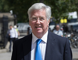 © Licensed to London News Pictures. 06/07/2016. London, UK. Defence Secretary Michael Fallon walks to Parliament on the day the Iraq Inquiry, Chaired by Sir John Chilcot, is finally published.  Photo credit: Peter Macdiarmid/LNP
