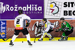 3.01.2014, Hala Tivoli, Ljubljana, SLO, EBEL, HDD Telemach Olimpija Ljubljana vs Dornbirner Eishockey Club, 63rd Game Day, in picture Chris D'Alvise (Dornbirner Eishockey Club, #15) and Ken Ograjensek (HDD Telemach Olimpija, #18) during the Erste Bank Icehockey League 63rd Game Day match between HDD Telemach Olimpija Ljubljana and Dornbirner Eishockey Club at the Hala Tivoli, Ljubljana, Slovenia on 2014/01/03. (Photo By Matic Klansek Velej / Sportida)