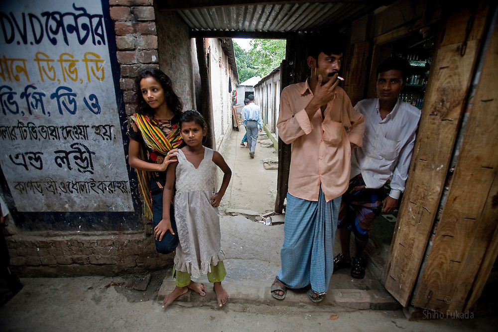 Nodi,14, left, and cousin Suma, 8, are seen at brothel in Tangail, Bangladesh. Nodi run away from home after falling in love with a Hindu boy and ended up in the brothel with her sister. Suma's mother is a sex worker. <br />