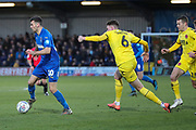 AFC Wimbledon attacker Adam Roscrow (10) dribbling past Fleetwood Town  defender Harry Souttar (6) during the EFL Sky Bet League 1 match between AFC Wimbledon and Fleetwood Town at the Cherry Red Records Stadium, Kingston, England on 8 February 2020.