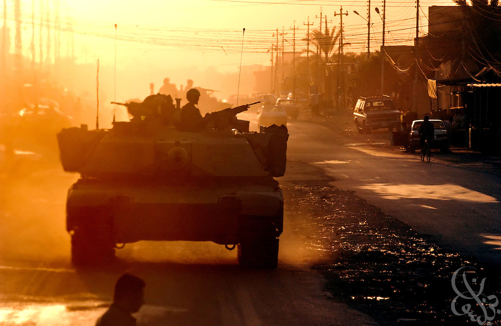 A U.S. Army 4th Infantry Division, 1st Battallion, 66th Armored regiment tank patrols the streets of Samarra, Iraq August 24, 2003.