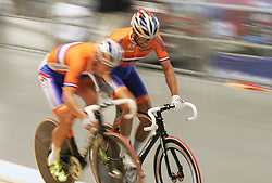 (Melbourne, Australia---08 April 2012) The Dutch (Netherlands) team makes a pass during the Madison at the 2012 UCI Track Cycling World Championships.Copyright 2012 Sean Burges / Mundo Sport Images.