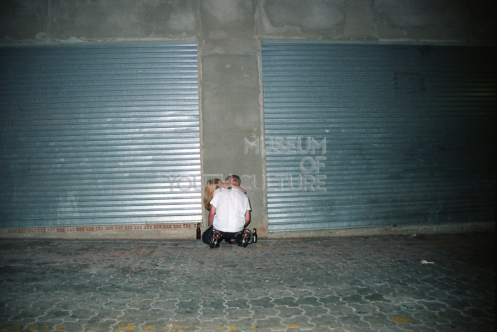 Couple kissing in the street. Ibiza 2006