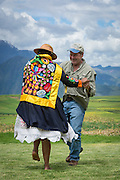 Doug Peebles dancing with local Quechua woman in the village of Moray; Sacred Valley, Peru.