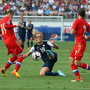 U.S. defender Kristie Mewis (19) kicks the ball against Russia defender Ksenia Tsybutovich (19) and Russia defender Ekaterina Dmitrenko (7) during an international friendly soccer match between the United States Women's National soccer team and the Russia National soccer team at FAU Stadium on Saturday, February 8, in Boca Raton, Florida. (AP Photo/Alex Menendez)