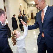 Rep. Josh Gottheimer's (D-NJ, 15) daughter, Ellie, high-fives Senator Corey Booker (D-NJ), after Sen. Booker stopped by Gottheimer's new office to wish him well,  on Wednesday January 3, 2017.  Rep. Gottheimer was sworn into the House of Representatives earlier in the day.  John Boal photo/for The Record