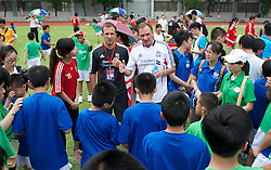 GUANGZHOU, CHINA - Wednesday, July 13, 2011: Liverpool's ambassador Phil Thompson during a coaching clinic for local youngsters at the Guangzhou Sports University during day three of the club's Asia Tour. (Photo by David Rawcliffe/Propaganda)