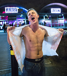 """© Licensed to London News Pictures . 16/11/2015 . Manchester , UK . A man rips open his t-shirt at the event . Annual student pub crawl """" Carnage """" at Manchester's Deansgate Locks nightclubs venue . The event sees students visit several clubs over the course of an evening . This year's theme is """" Animal Instinct - unleash your beast """" . Photo credit : Joel Goodman/LNP"""