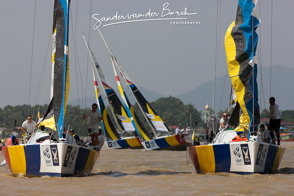 Sebastien Col (FRA) and Mathieu Richard (FRA) at the top mark with Ian Williams (GBR) and Adam Minoprio (NZL) in the background. Monsoon Cup 2009. Kuala Terengganu, Malaysia. 4 December 2009. Photo: Sander van der Borch / Subzero Images