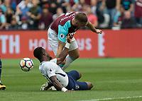 Football - 2017 / 2018 Premier League - West Ham United vs Tottenham Hotspur<br /> <br /> Serge Aurier (Tottenham FC)  times his tackle on Marko Arnautovic (West Ham United) at the London Stadium<br /> <br /> COLORSPORT/DANIEL BEARHAM