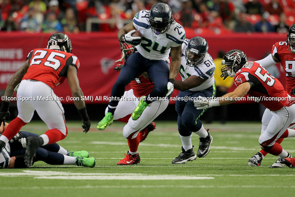 10 November 2013: Seattle Seahawks running back Marshawn Lynch (24) rushes in the Seattle Seahawks 33-10 victory over the Atlanta Falcons at the Georgia Dome in Atlanta Georgia.