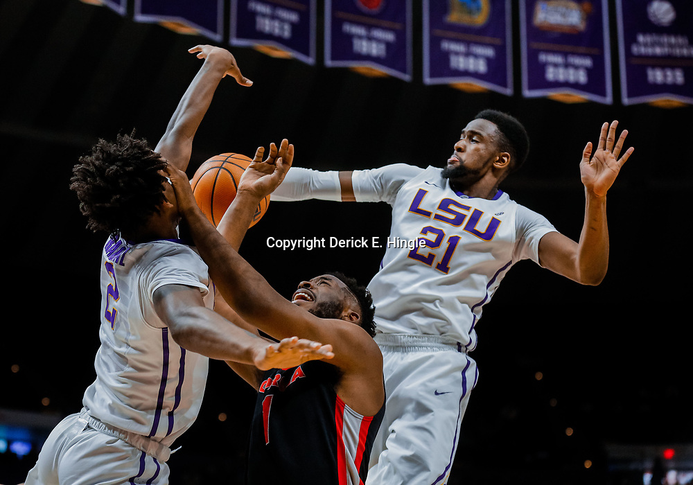 Jan 16, 2018; Baton Rouge, LA, USA; LSU Tigers forward Aaron Epps (21) blocks a shot by Georgia Bulldogs forward Yante Maten (1) as guard Brandon Rachal (2) defends during the first half at the Pete Maravich Assembly Center. Mandatory Credit: Derick E. Hingle-USA TODAY Sports