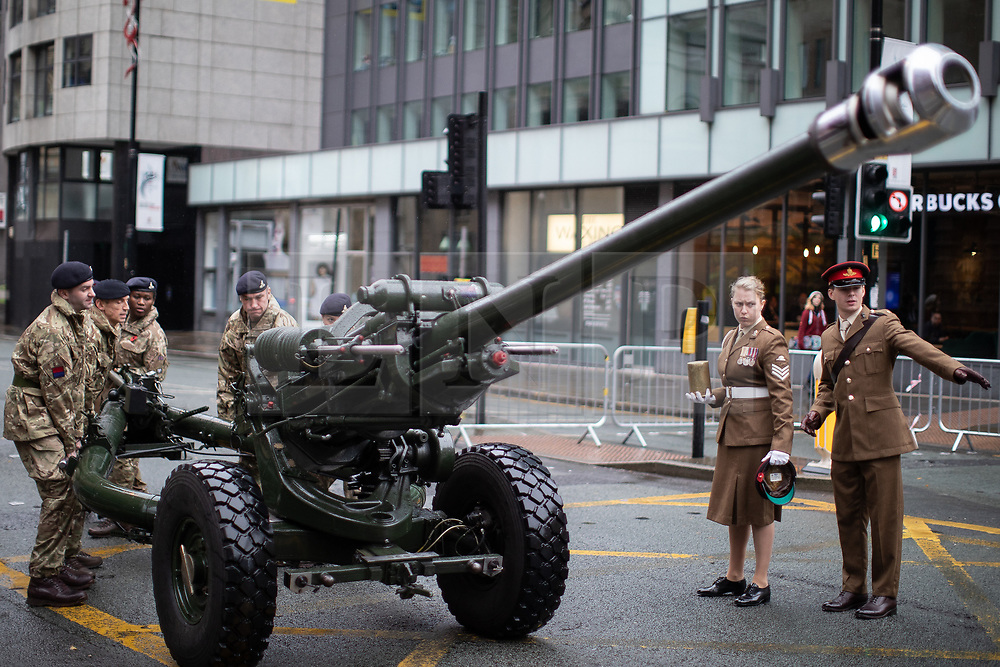 © Licensed to London News Pictures . 11/11/2018. Manchester , UK . A ceremonial field gun is prepared ahead of being fired at 11am ahead of a service of remembrance for those killed in war to be held at 11am at the Manchester Cenotaph in St Peter's Square , on the 100th anniversary of Armistice Day , marking the end of the First World War . Photo credit : Joel Goodman/LNP