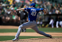 OAKLAND, CA - JULY 23:  Bo Schultz #47 of the Toronto Blue Jays pitches against the Oakland Athletics during the ninth inning at O.co Coliseum on July 23, 2015 in Oakland, California. The Toronto Blue Jays defeated the Oakland Athletics 5-2. (Photo by Jason O. Watson/Getty Images) *** Local Caption *** Bo Schultz