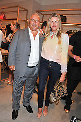 SIR PHILIP GREEN and EMMA HILL at a party to celebrate the launch of the Vogue Fashion's Night Out held at Mulberry, Bond Street, London on 6th September 2012.