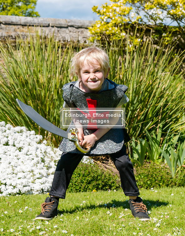 Medieval Day. Dirleton Castle, East Lothian, Scotland, United Kingdom, 11 May 2019. Pictured:  Medieval Day: Finn, aged 6 years, gets into the fighting spirit. Historic Environment Scotland family fun day at the Living Medieval Village by Saltire History Society in the castle gardens. <br /> <br /> Sally Anderson | EdinburghElitemedia.co.uk