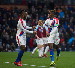 Wilfried Zaha of Crystal Palace (R) celebrates scoring his sides third goal - Mandatory by-line: Jack Phillips/JMP - 02/03/2019 - FOOTBALL - Turf Moor - Burnley, England - Burnley v Crystal Palace - English Premier League