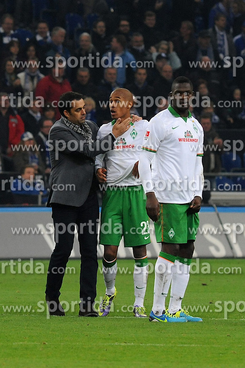 09.11.2013, Veltins Arena, Gelsenkirchen, GER, 1. FBL, Schalke 04 vs SV Werder Bremen, 12. Runde, im Bild V l n r Trainer Robin Dutt, Theodor Gebre Selassie, Assani Lukimya ( alle SV Werder Bremen / Emotion ) total enttaeuscht ueber die Niederlage // during the German Bundesliga 12th round match between Schalke 04 and SV Werder Bremen at the Veltins Arena in Gelsenkirchen, Germany on 2013/11/09. EXPA Pictures &copy; 2013, PhotoCredit: EXPA/ Eibner-Pressefoto/ Thienel<br /> <br /> *****ATTENTION - OUT of GER*****