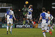 Doncaster Rovers Rodney Kongolo (7)  and  Bristol Rovers Stuart Sinclair (24)go for the high ball  during the EFL Sky Bet League 1 match between Bristol Rovers and Doncaster Rovers at the Memorial Stadium, Bristol, England on 23 December 2017. Photo by Gary Learmonth.