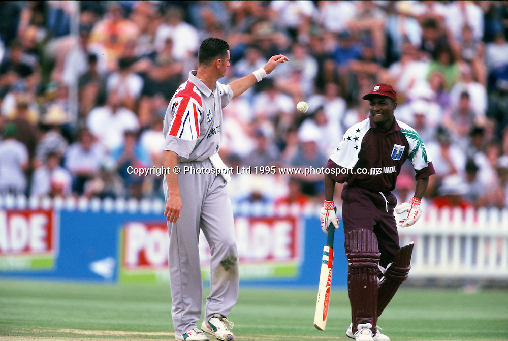 Brian Lara hands ball to Simon Doull - NZ v West Indies - 2nd ODI - Basin Reserve, 25 January 1995