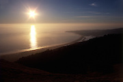 The sun over the Pacific Ocean along Stinson Beach in Marin County, California, USA.