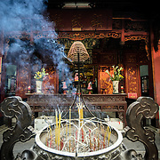Incense sticks burn in an urn at Quan Thanh Temple in Hanoi. The Taoist temple dates back to the 11th century and is located close to West Lake.
