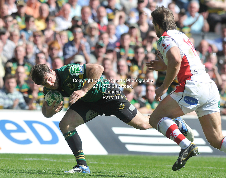 10/04/2011 - Heineken Cup Quarer Final Rugby - Northampton Saints vs Ulster - Ben Foden gets ready to tack a tackle for Northampton. - Photo: Charlie Crowhurst / Offside.