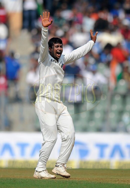 Pragyan Ojha of India appeals successfully for the wicket of Shane Shillingford of West Indies during day one of the second Star Sports test match between India and The West Indies held at The Wankhede Stadium in Mumbai, India on the 14th November 2013<br /> <br /> This test match is the 200th test match for Sachin Tendulkar and his last for India.  After a career spanning more than 24yrs Sachin is retiring from cricket and this test match is his last appearance on the field of play.<br /> <br /> Photo by: Pal PIllai - BCCI - SPORTZPICS<br /> <br /> Use of this image is subject to the terms and conditions as outlined by the BCCI. These terms can be found by following this link:<br /> <br /> http://sportzpics.photoshelter.com/gallery/BCCI-Image-Terms/G0000ahUVIIEBQ84/C0000whs75.ajndY