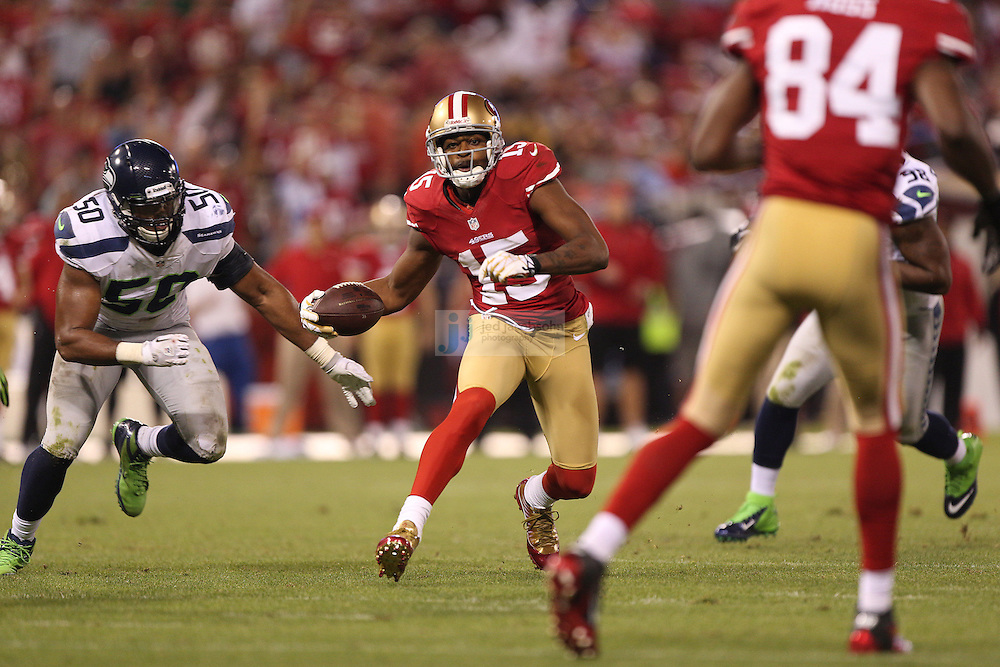 San Francisco 49ers wide receiver Michael Crabtree (15) runs against the Seattle Seahawks on Thursday, Oct. 18, 2012 at Candlestick Park in San Francisco. (AP Photo/Jed Jacobsohn)