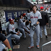 NEW YORK, NEW YORK - July 05: Christian Yelich #21 of the Miami Marlins in the dugout preparing to bat during the Miami Marlins Vs New York Mets regular season MLB game at Citi Field on July 04, 2016 in New York City. (Photo by Tim Clayton/Corbis via Getty Images)