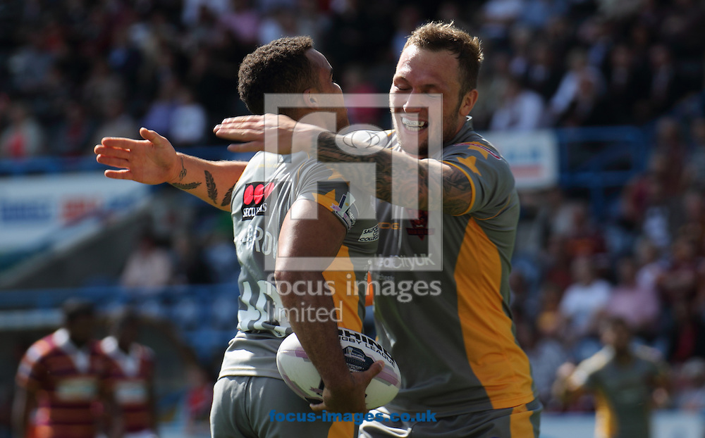 Mason Caton Brown (L) celebrates scoring his try with team mate Josh Griffin (R) of Salford Red Devils during the First Utility Super League match at the John Smiths Stadium, Huddersfield<br /> Picture by Stephen Gaunt/Focus Images Ltd +447904 833202<br /> 05/07/2014