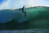 Surfing Grajagan Bay or G-Land in East Java, Indonesia