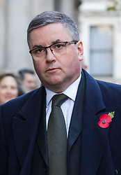 © Licensed to London News Pictures. 10/11/2019. London, UK. Lord Chancellor Robert Buckland walks through Downing Street to attend the Remembrance Sunday Ceremony at the Cenotaph in Whitehall. Remembrance Sunday events are held across the country today as the UK remembers and honours those who have sacrificed themselves in two world wars and other conflicts. Photo credit: Vickie Flores/LNP