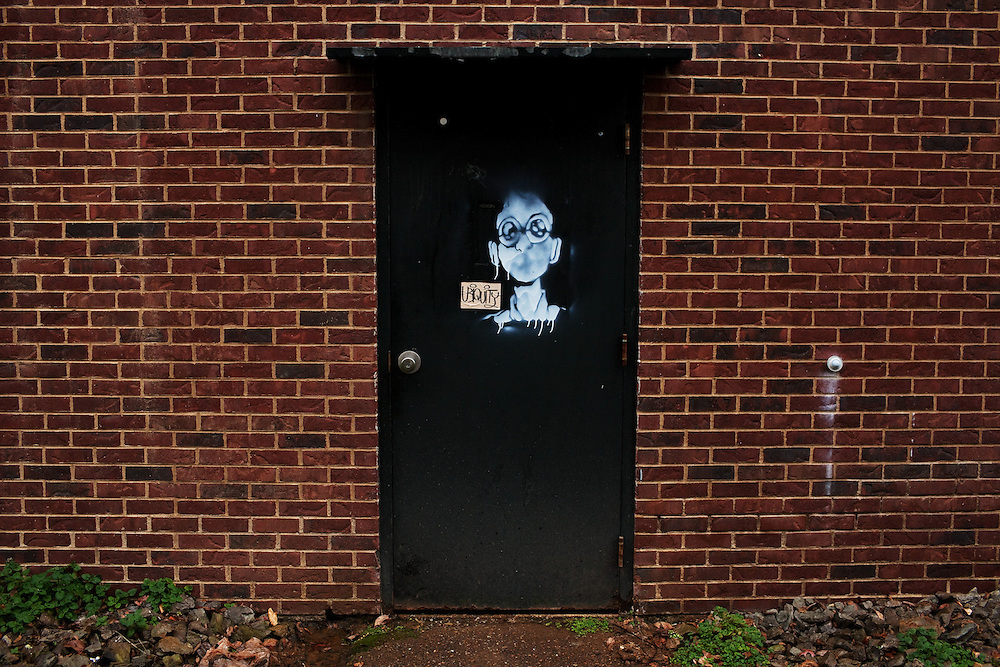 A door outside Ohio University's Robert Glidden Hall displays waterlogged graffiti in Athens, Ohio on Sunday, December 2, 2012. Photo by Chris Franz