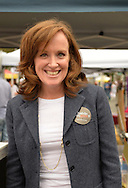 Merrick, New York, USA. 13th September 2014. Congressional candidate KATHLEEN RICE wears a 'What do you Geek?' sticker at the 23rd Annual Merrick Fall Festival & Street Fair in suburban Long Island. The Merrick Library booth gave visitors 'What do you geek?' stickers, by the non-profit nonpartisan Geek the Library organization.