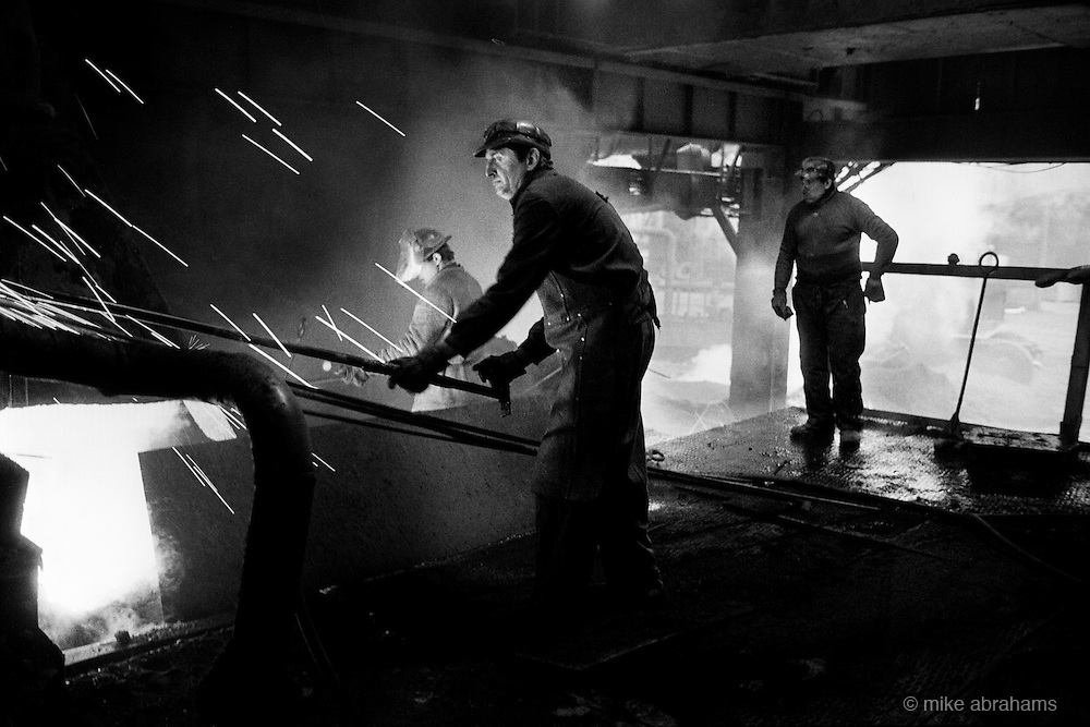 Workers at the Carbosin Plant manufacturing Carbon Blackiing. The plant was repsonsible for covering the whole area in a dense fog of black dust, which combined with the deasly pollutants from the neighboring Lead and Zinc works caused massive health problems in the area.. Copsa Mica, Transylvania, Romania. Feb 1990