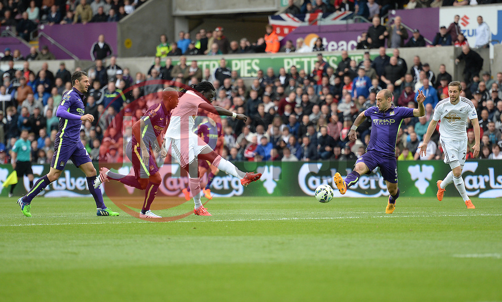 Swansea City's Bafetibis Gomis shoots and forces a save from Manchester City's Joe Hart - Photo mandatory by-line: Alex James/JMP - Mobile: 07966 386802 - 17/05/2015 - SPORT - Football - Swansea - The Liberty stadium - Swansea City v Manchester City - Barclays premier league