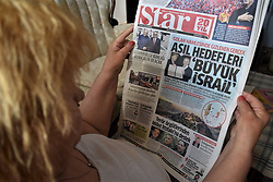 March 27, 2019 - Ankara, Turkey - Star, a Turkish pro-government daily newspaper, runs a headline on its front page that reads 'The primary objective is Greater Israel' after U.S. President DONALD TRUMP has officially recognised Israeli sovereignty over the Golan Heights. (Credit Image: © Altan Gocher/ZUMA Wire)