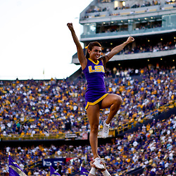 October 16, 2010; Baton Rouge, LA, USA; A LSU Tigers cheerleader performs during a game against the McNeese State Cowboys at Tiger Stadium. LSU defeated McNeese State 32-10. Mandatory Credit: Derick E. Hingle